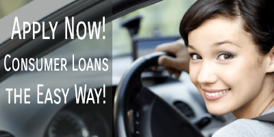 Young woman driving her new car financed with a Catlin Bank consumer loan.